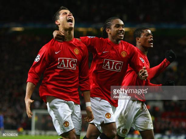 Cristiano Ronaldo of Manchester United celebrates scoring the opening goal with team mates Anderson and Patrice Evra during the UEFA Champions League...