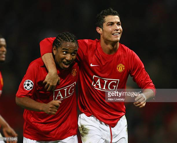Cristiano Ronaldo of Manchester United celebrates scoring the winning goal with team mate Anderson during the UEFA Champions League Group F match...