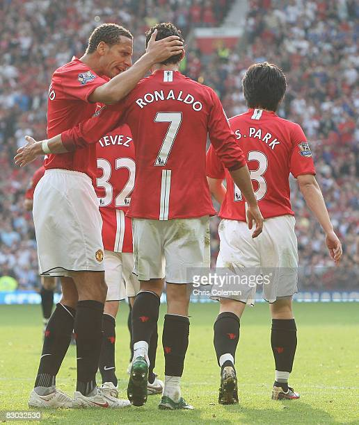 Cristiano Ronaldo of Manchester United celebrates scoring their first goal during the FA Premier League match between Manchester United and Bolton...