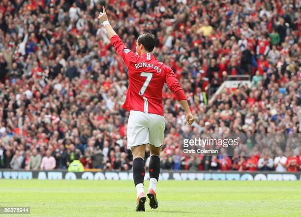 Cristiano Ronaldo of Manchester United celebrates scoring their first goal during the Barclays Premier League match between Manchester United and...