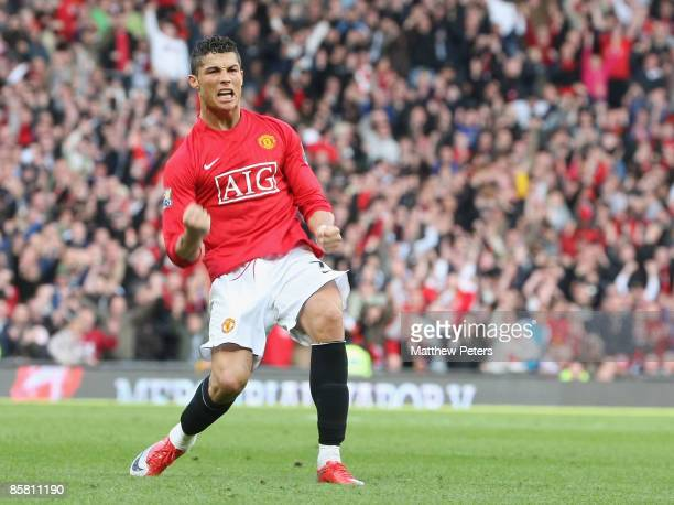 Cristiano Ronaldo of Manchester United celebrates scoring their second goal during the Barclays Premier League match between Manchester United and...