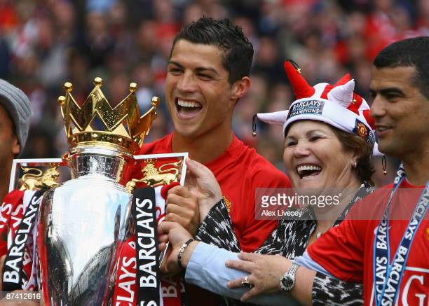 Cristiano Ronaldo of Manchester United celebrates winning the Barclays Premier League trophy with his mother Dolores Aveiro after the Barclays...
