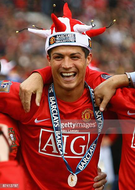 Cristiano Ronaldo of Manchester United celebrates winning the Barclays Premier League trophy after the Barclays Premier League match between...