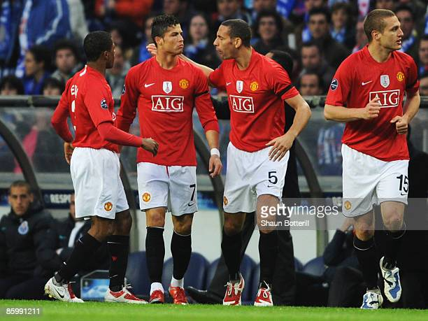 Cristiano Ronaldo of Manchester United celebrates with Rio Ferdinand and Patrice Evra as he scores their first goal during the UEFA Champions League...