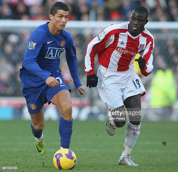 Cristiano Ronaldo of Manchester United clashes with Amdy Faye of Stoke CIty during the Barclays Premier League match between Stoke City and...