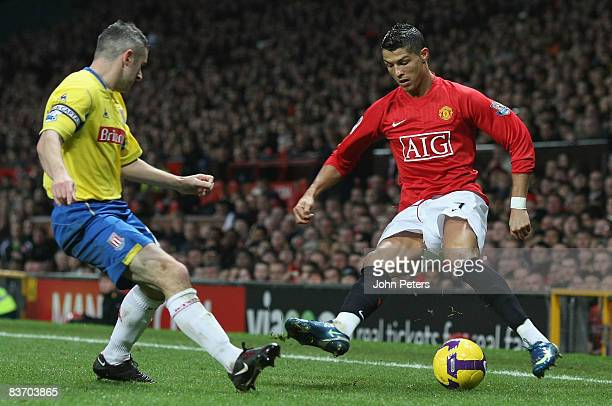Cristiano Ronaldo of Manchester United clashes with Andy Griffin of Stoke City during the Barclays Premier League match between Manchester United and...