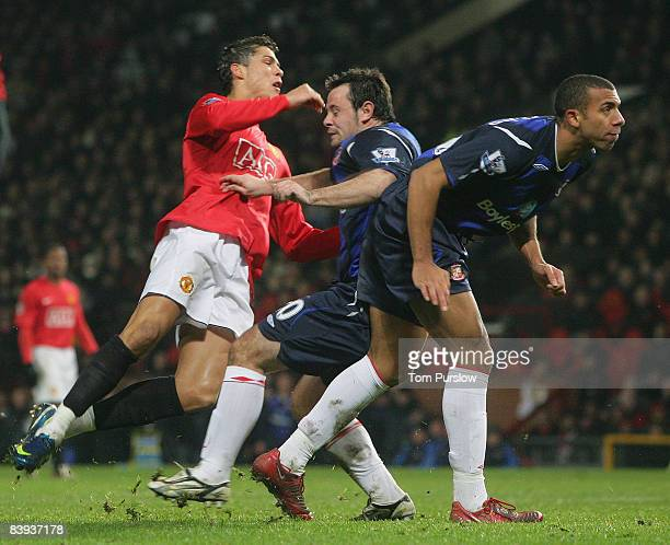 Cristiano Ronaldo of Manchester United clashes with Andy Reid of Sunderland picking up an injury during the Barclays Premier League match between...