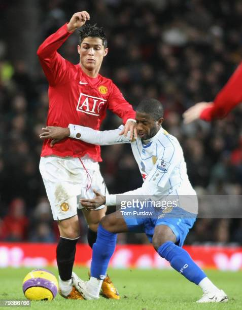 Cristiano Ronaldo of Manchester United clashes with Arnold Mvuemba of Portsmouth during the Barclays FA Premier League match between Manchester...