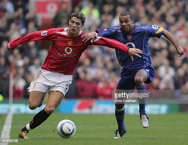 Cristiano Ronaldo of Manchester United clashes with Ashley Cole of Arsenal during the Barclays Premiership match between Manchester United and...