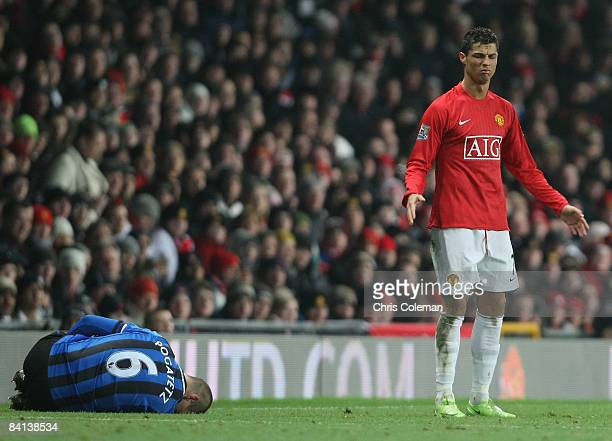 Cristiano Ronaldo of Manchester United clashes with Emmanuel Pogatetz of Middlesbrough during the Barclays Premier League match between Manchester...