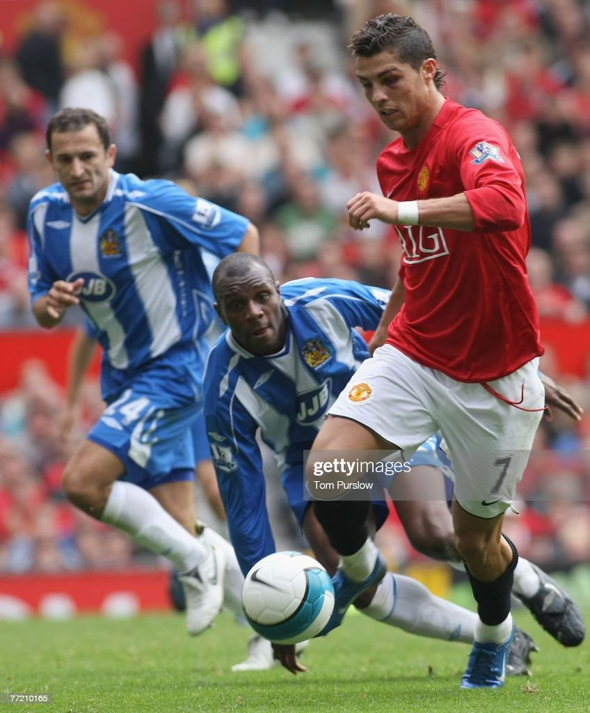 Cristiano Ronaldo of Manchester United clashes with Emmerson Boyce of Wigan Athletic during the Barclays FA Premier League match between Manchester United and Wigan Athletic at Old Trafford on October 6 2007, in Manchester, England.