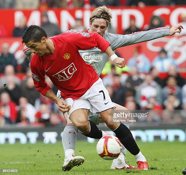 Cristiano Ronaldo of Manchester United clashes with Fernando Torres of Liverpool during the Barclays Premier League match between Manchester United...
