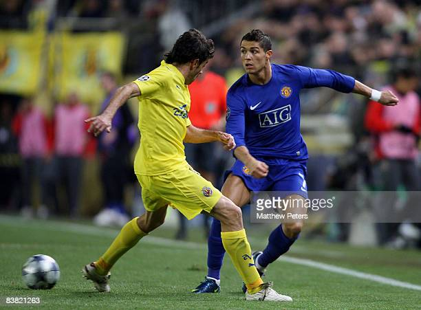 Cristiano Ronaldo of Manchester United clashes with Javi Venta of Villarreal during the UEFA Champions League Group E game between Villarreal and...