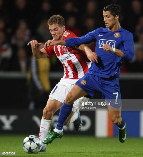 Cristiano Ronaldo of Manchester United clashes with Kasper Risgard of Aalborg BK during the UEFA Champions League Group E match between Aalborg BK...