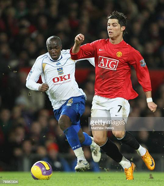 Cristiano Ronaldo of Manchester United clashes with Lassana Diarra of Portsmouth during the Barclays FA Premier League match between Manchester...