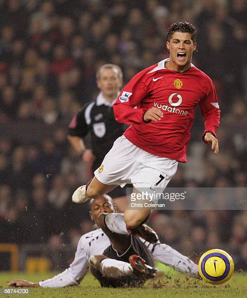 Cristiano Ronaldo of Manchester United clashes with Luis Boa Morte of Fulham during the Barclays Premiership match between Manchester United and...