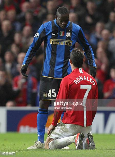 Cristiano Ronaldo of Manchester United clashes with Mario Balotelli of Inter Milan during the UEFA Champions League First Knockout Round Second Leg...