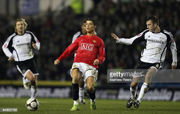 Cristiano Ronaldo of Manchester United clashes with Paul Connolly of Derby County during the FA Cup sponsored by eon Fifth Round match between Derby...