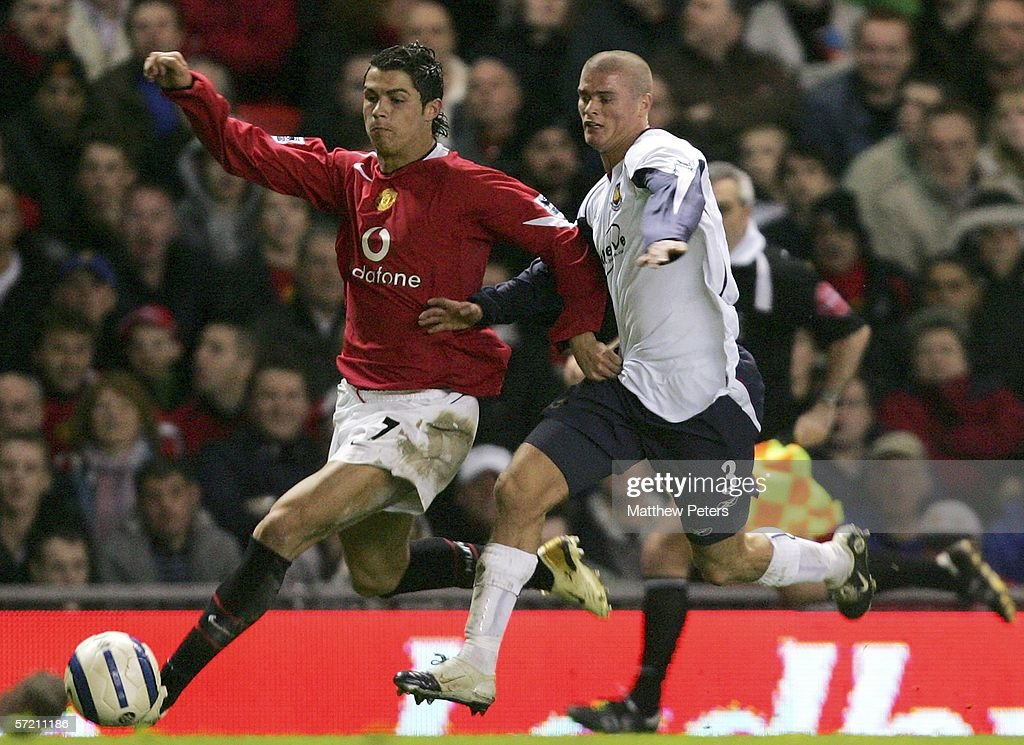 Cristiano Ronaldo of Manchester United clashes with Paul Konchesky of West Ham United during the Barclays Premiership match between Manchester United and West Ham United at Old Trafford on March 29 2006 in Manchester, England.