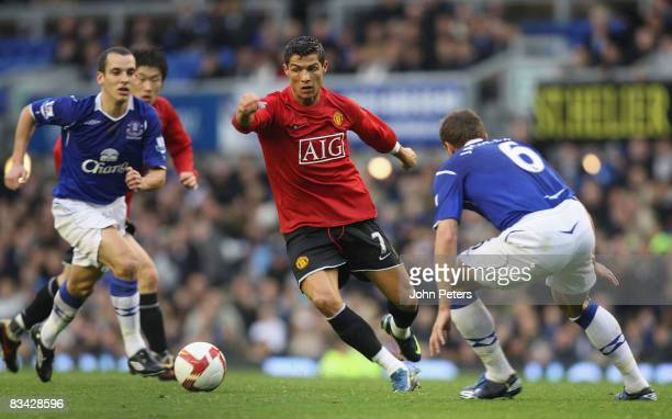 Cristiano Ronaldo of Manchester United clashes with Phil Jagielka of Everton during the Barclays Premier League match between Everton and Manchester...