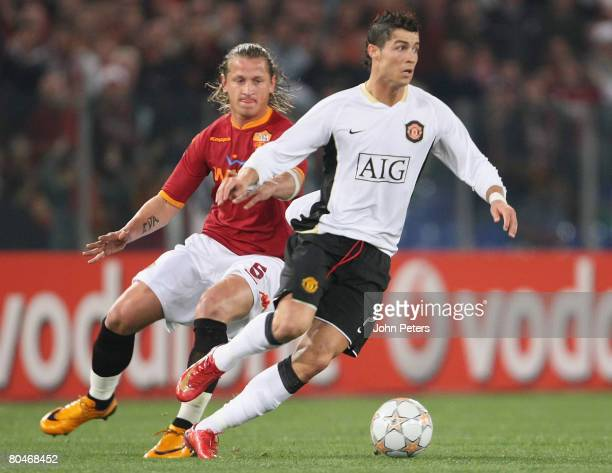 Cristiano Ronaldo of Manchester United clashes with Philippe Mexes of AS Roma during the UEFA Champions League quarterfinal match betwen AS Roma and...