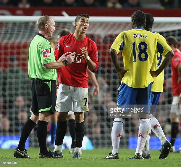 Cristiano Ronaldo of Manchester United clashes with Salif Diao of Stoke City during the Barclays Premier League match between Manchester United and...
