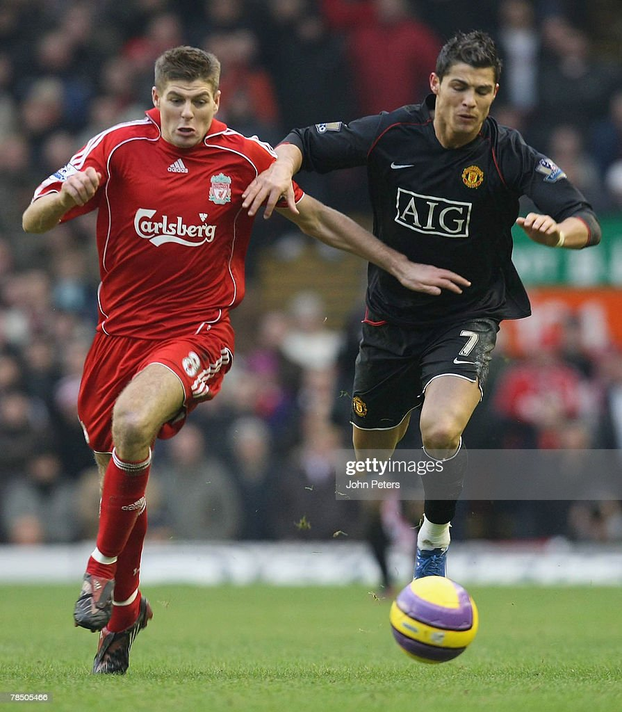 Cristiano Ronaldo of Manchester United clashes with Steven Gerrard of Liverpool during the Barclays FA Premier League match between Liverpool and...