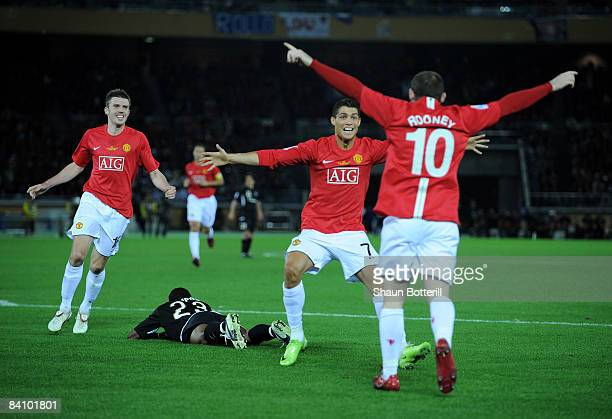 Cristiano Ronaldo of Manchester United congratulates teammate Wayne Rooney during the FIFA Club World Cup Japan 2008 Final match between Manchester...