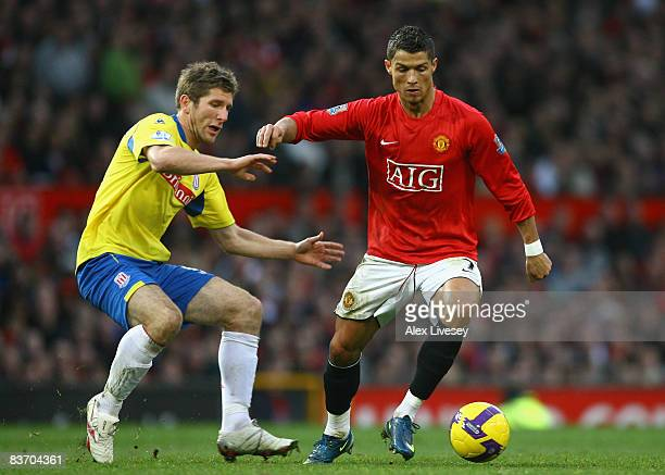 Cristiano Ronaldo of Manchester United goes past Richard Cresswell of Stoke City during the Barclays Premier League match between Manchester United...