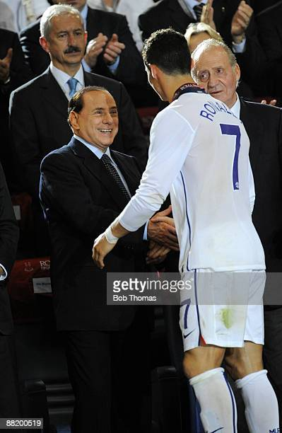 Cristiano Ronaldo of Manchester United greeted by Italian Prime Minister Silvio Berlusconi during the medals presentation after the UEFA Champions...