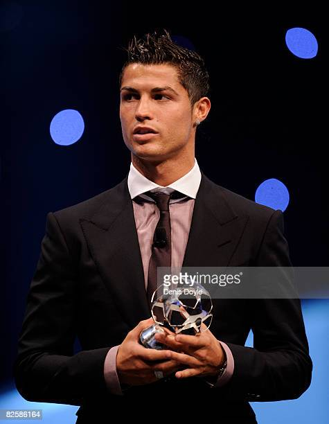 Cristiano Ronaldo of Manchester United holds his award for Forward of the past season at the UEFA Champions League Draw for the 2008/2009 season at...
