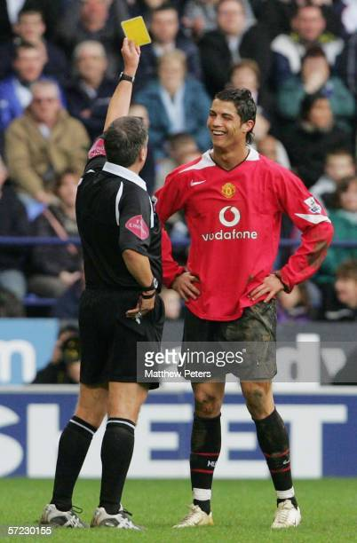 Cristiano Ronaldo of Manchester United is booked by referee Alan Wiley during the Barclays Premiership match between Bolton Wanderers and Manchester...
