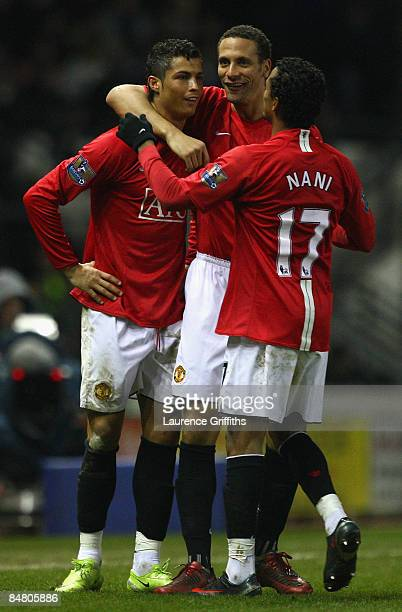 Cristiano Ronaldo of Manchester United is congratulated by Rio Ferdinand and Nani after scoring the third goal during the FA Cup sponsored by Eon...