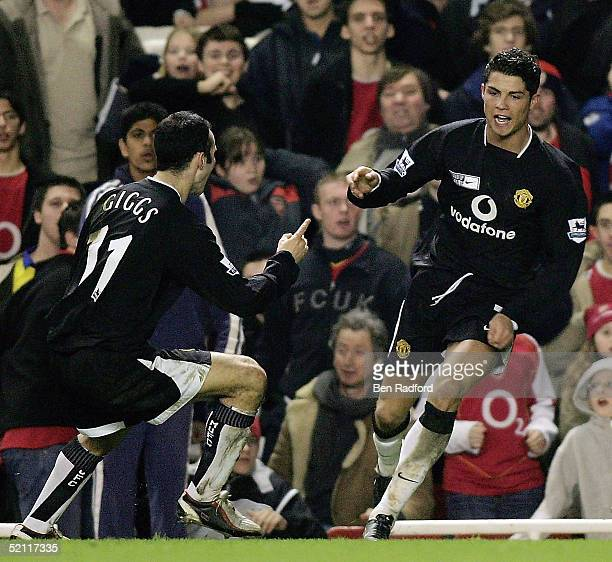 Cristiano Ronaldo of Manchester United is congratulated by Ryan Giggs after scoring their second goal of the game during the Barclays Premiership...