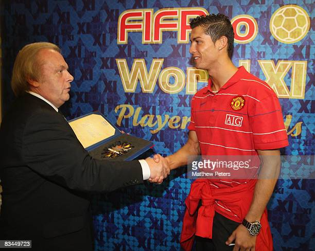 Cristiano Ronaldo of Manchester United is presented with his FIFPRO World XI award by Gordon Taylor of the PFA at Carrington Training Ground on...