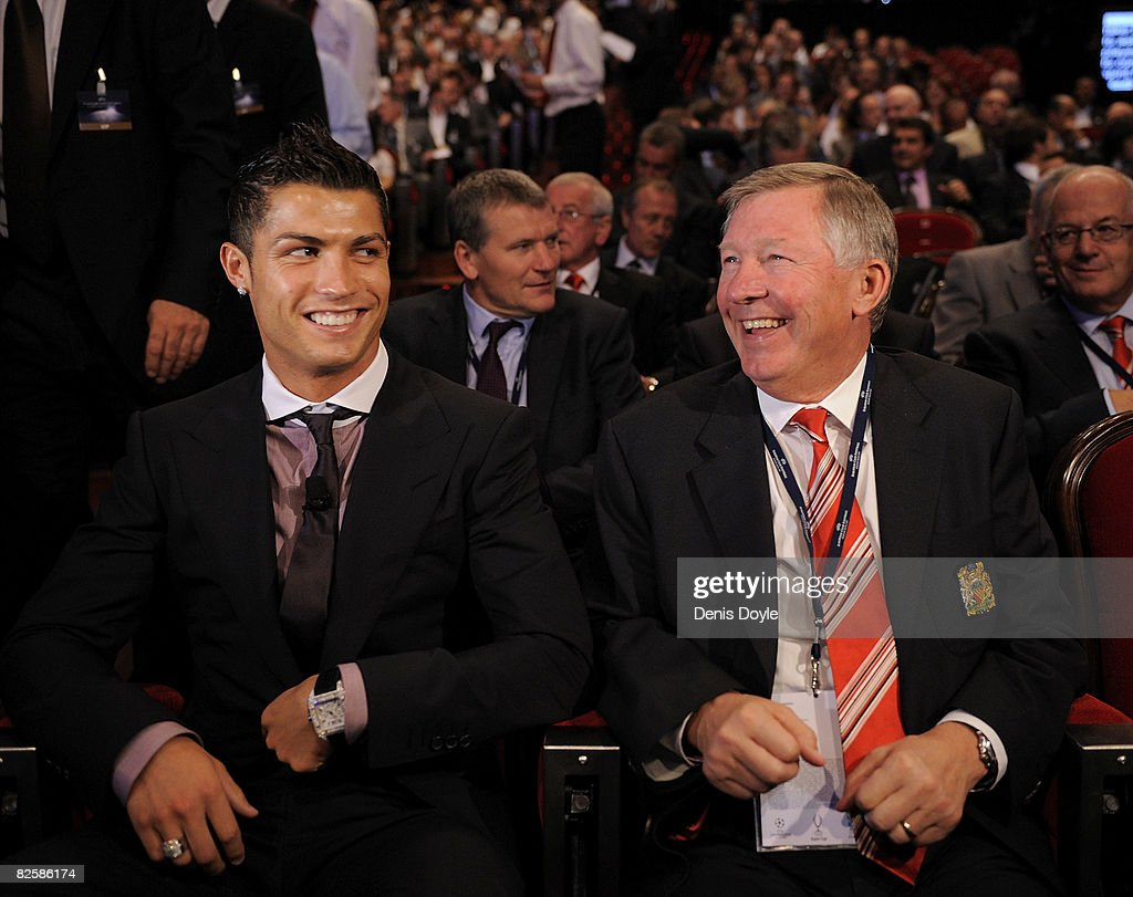 <a gi-track='captionPersonalityLinkClicked' href=/galleries/search?phrase=Cristiano+Ronaldo&family=editorial&specificpeople=162689 ng-click='$event.stopPropagation()'>Cristiano Ronaldo</a> (L) of Manchester United laughs with his manager Sir <a gi-track='captionPersonalityLinkClicked' href=/galleries/search?phrase=Alex+Ferguson&family=editorial&specificpeople=203067 ng-click='$event.stopPropagation()'>Alex Ferguson</a> while attending the UEFA Champions League Draw for the 2008/2009 season at the Grimaldi Center on August 28, 2008 in Monte Carlo, Monaco.
