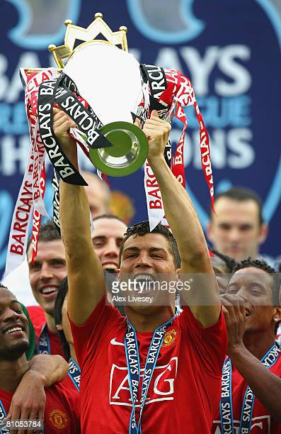 Cristiano Ronaldo of Manchester United lifts the Barclays Premier League Trophy after the Barclays Premier League match between Wigan Athletic and...