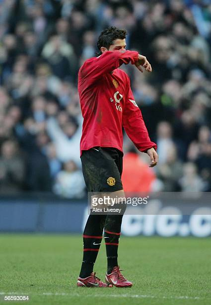 Cristiano Ronaldo of Manchester United looks dejected as he is sent off during the Barclays Premiership match between Manchester City and Manchester...