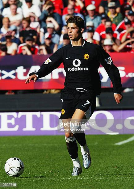 Cristiano Ronaldo of Manchester United looks up while running with the ball during the FA Barclaycard Premiership match between Charlton Athletic and...