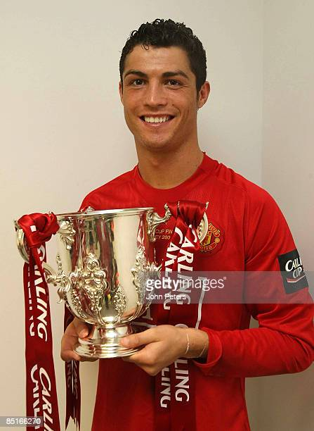 Cristiano Ronaldo of Manchester United poses in the dressing room with the Carling Cup trophy after the Carling Cup Final match between Manchester...