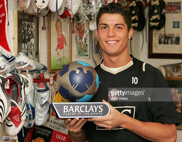 Cristiano Ronaldo of Manchester United poses with his Barclays Player of the Month trophy for November at Carrington Training Ground on December 8...