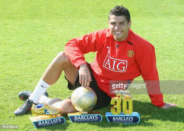 Cristiano Ronaldo of Manchester United poses with his Barclays Player of the Year Golden Boot and 30 League Goals awards at Carrington Training...