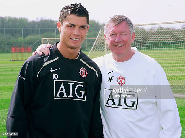 Cristiano Ronaldo of Manchester United poses with Sir Alex Ferguson after agreeing a new fiveyear deal at the club during a first team training...