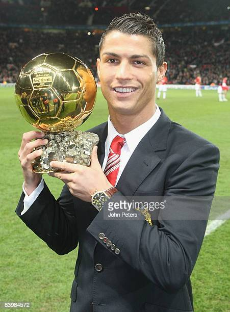 Cristiano Ronaldo of Manchester United poses with the Ballon D'Or ahead of the UEFA Champions League Group E match between Manchester United and...