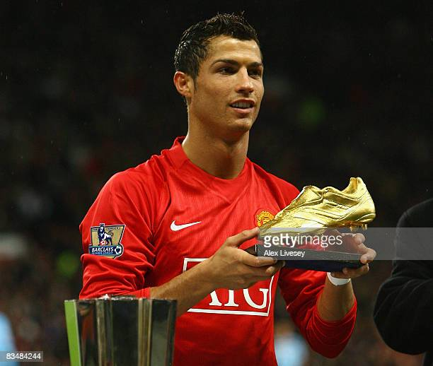 Cristiano Ronaldo of Manchester United poses with the European Golden Boot award as Europe's top scorer for the 2007 – 2008 season before the...