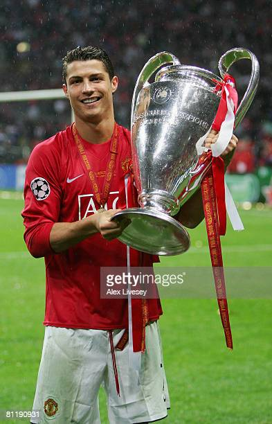 Cristiano Ronaldo of Manchester United poses with the trophy following his team's victory during the UEFA Champions League Final match between...