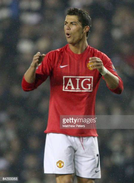Cristiano Ronaldo of Manchester United reacts to his freekick narrowly missing the target during the Carling Cup SemiFinal First Leg match between...