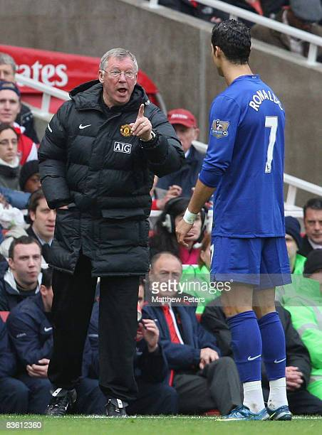 Cristiano Ronaldo of Manchester United receives instructions from Sir Alex Ferguson during the Barclays Premier League match between Arsenal and...