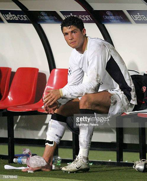 Cristiano Ronaldo of Manchester United receives treatment for an injury during the UEFA Champions League First Knockout Round match between Lille OSC...