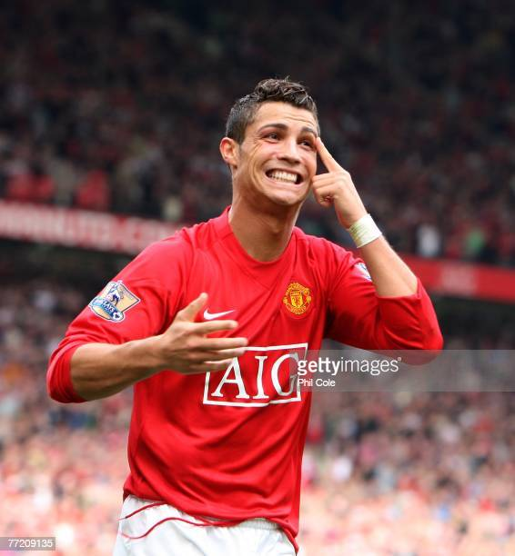 Cristiano Ronaldo of Manchester United scores against Wigan Athletic and point to his cut on his eye while celabrating during the Barclays Premier...